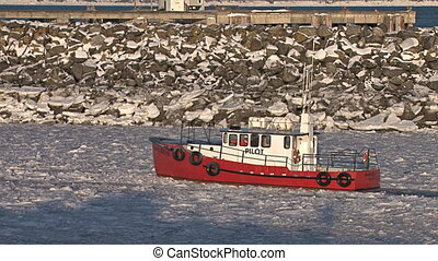 Red Pilot Boat Icy Harbor 2 - A red pilot boat returns to...