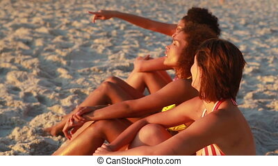 Friends sitting at the beach together