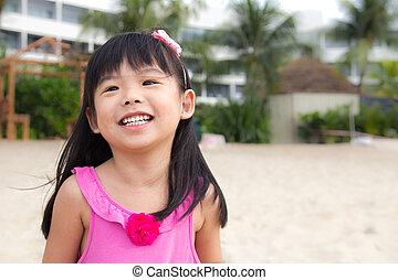 Laughing child - Portrait of a happy child girl at beach