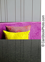 decorative pillows on a contemporary sofa with table