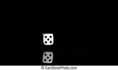 One white dices in super slow motion rebonding against a...