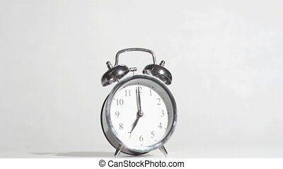 Alarm clock sounds in a super slow motion crushing by a...