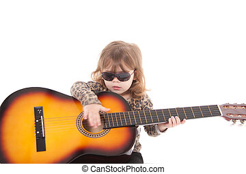 Child holding a guitar - little girl playing a guitar