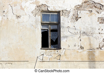 Broken window in abandoned house - Broken window in old...