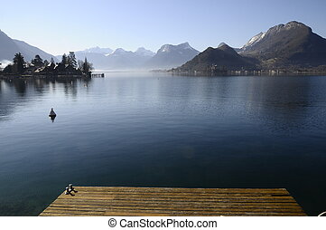 Annecy lake from Talloires harbour and wooden pontoon on...