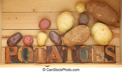 potato varieties - the word potatoes in old wood type with...