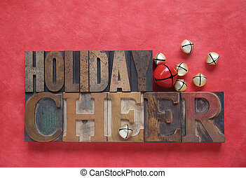 holiday cheer - the words holiday cheer with bells on a red...