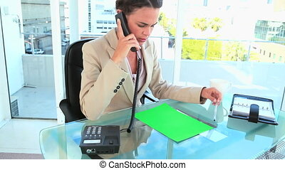Woman on the phone file copy space file on her desk in a...