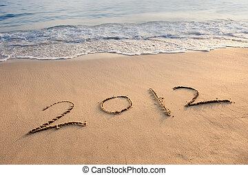 """inscription """"2012"""" on a beach"""