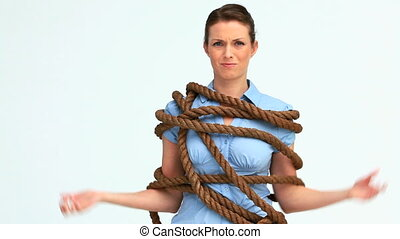 Woman attached with a big rope against white background