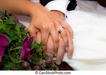 Wedding hands - Newly wed couple holding hands