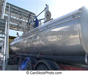 worker fill truck tank - worker with uniform. freight car...
