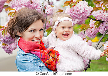 Mother with baby in the garden