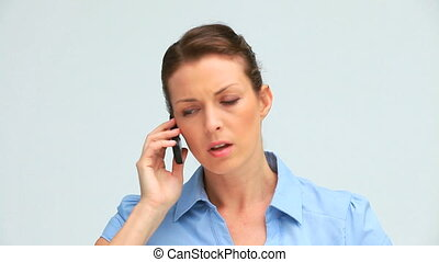 Upset businesswoman on the phone against white background