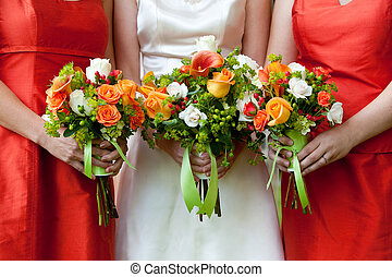 wedding bouquet - three wedding bouquets being held by a...