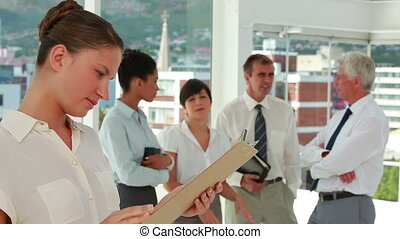Business people standing and talking in a bright room