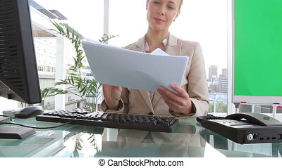 Businesswoman reading documents in an office