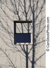 Shadow of a tree in winter on white building with window and...