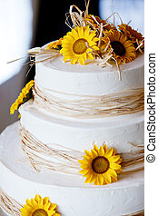 wedding cake - a white wedding cake with yellow flowers and...