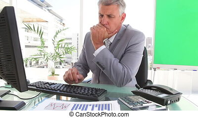 Businessman looking at statistics in an office