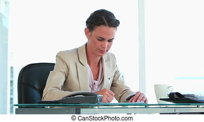 Well-dressed woman working in a bright office