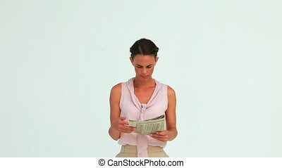 Businesswoman reading the news posing with a smile