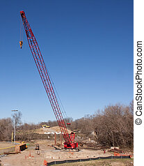 Red Crane - Tall red heavy-duty mobile crane ready to lift