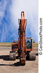 Jackhammer on end of excavator - Jackhammer on end of orange...