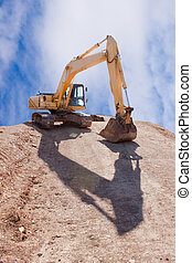 Excavator on construction Site - Excavator on construction...