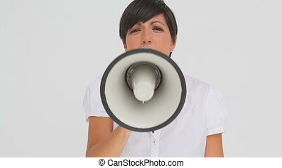 Brunette haired businesswoman talking through a megaphone...