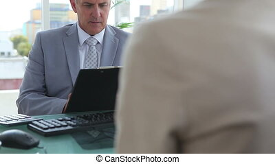 Businessman interviewing a woman in an office