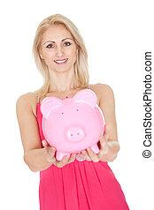 Beautiful woman holding a piggybank