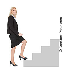 Successful businesswoman walking up a staircase. Isolated on...