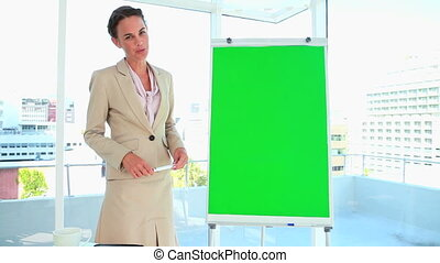 Woman in suit giving a presentation