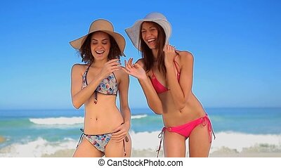 Happy women having fun on the beach