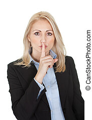 Beautiful business woman making a silence gesture Isolated...