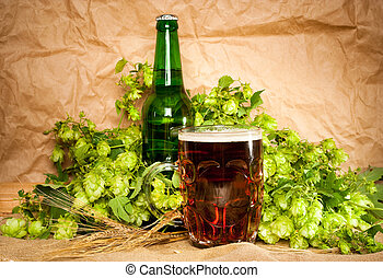 beer with hop and wheat on sacking still-life