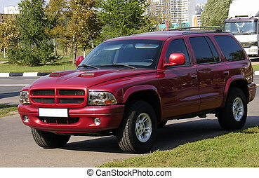 SUV heavy car - Red SUV Dodge Durango, summer sunny shot
