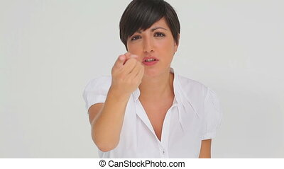 Businesswoman having an argument against a white background