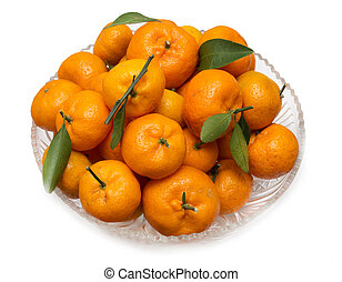 oranges with leaves on a plate