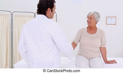 Serious doctor examining a mature woman