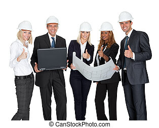 Smiling construction workers with building plan