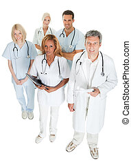 Diverse medical team looking up on white