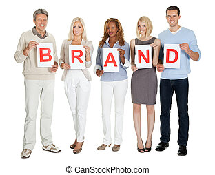 Casual group of people with a brand sign board isolated on...