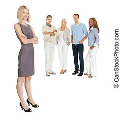 Business woman standing with colleagues - Pretty business...