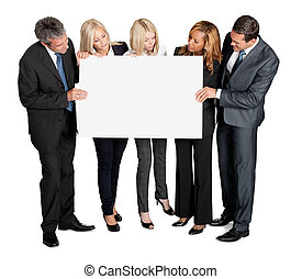 Business people looking at blank board in their hands on...