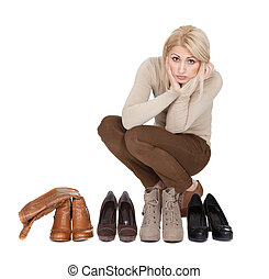 Beautiful young woman choosing shoes to wear Isolated on...