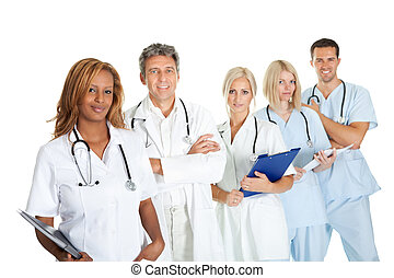 Smiling multi ethnic medical team against white - Portrait...