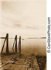 Maine coast - Three pylons along a boat ramp Located along...