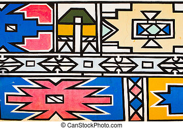 A bright and colorful Ndebele hut pattern photographed in...